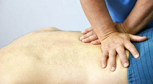 Лечение руками при болях в пояснице
